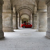 Contrasting image of a car through a 16th century arcade. Spain