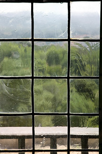 View through a very old window with ancient glass