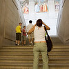 "A visitor taking photos at El Escorial staircase, Spain. The staircase was made by Giambattista Castello, called ""Il Bergamasco"" (16th century). The fresco paintings are a work by the Spanish painter Lucas Jordan (17th century)"