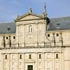 The Royal Monastery of San Lorenzo del Escorial was begun in 1563 by Juan Bautista de Toledo, a Renaissance Spanish architect who had worked earlier in Italy, and was completed after his death in 1567 by Juan de Herrera, who finished the work in 1584. The massive walls of the interior, relieved only by Doric pilasters with no concession to decorative richness, produced a monument that was austere beyond anything the Italian Renaissance ever envisaged. On the exterior the gigantic scale of the monastery and the severe gray granite walls are forbidding. There Herrera established his fame and the Herreran style, which was to prevail in Spain for half a century. According to the desire of the king Philip II, most Spanish sovereigns, beginning with the emperor Charles V and Philip II himself, were buried at El Escorial.