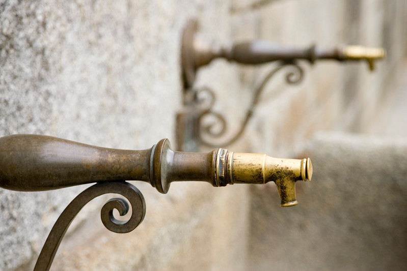 Detail of the faucet of an old drinking fountain, El Escorial, Spain