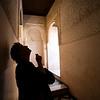 Visitor examining a corridor ceiling, Alhambra, Granada, Spain