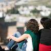 Women looking at the city of Granada from Alhambra hill, Spain