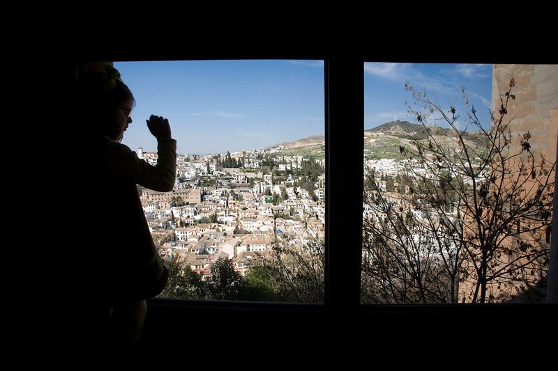 View of Granada through the windows of Sala Dorada, Alhambra, Spain