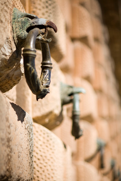 Rings hanging from eagle beaks, ornament on the wall of the Palace of Charles V, Granada, Spain