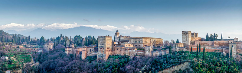 Panoramic view of the Alhambra hill with the Nasrid and Charles V palaces, Granada, Spain.