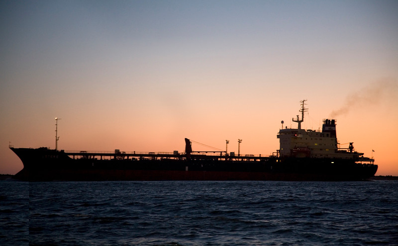 Cargo ship at dusk, port of Huelva, Andalusia, southwestern Spain