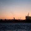 Cargo ship at dusk, port of Huelva, Andalusia, southwestern Spain