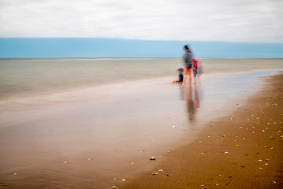 Kids on the beach, long exposure shot.