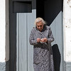 Old lady at her house's door, town of Casta–o del Robledo, province of Huelva, Andalusia, Spain