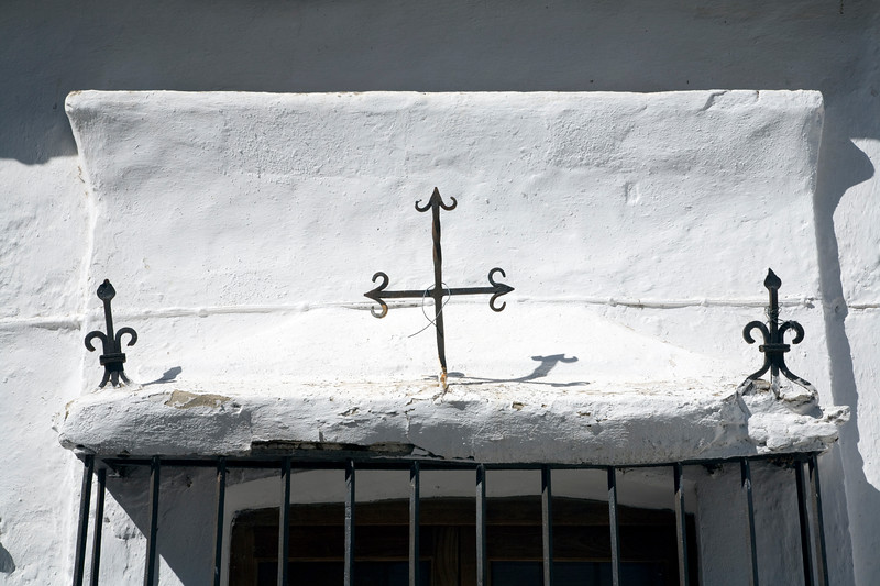 Cross on the top of a window, town of Casta–o del Robledo, province of Huelva, Andalusia, Spain