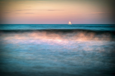 Sailboat over the horizon, long exposure shot. Ayamonte, Spain.