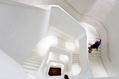 CaixaForum main stair in white concrete, work by Herzog & de Meuron, Madrid, Spain