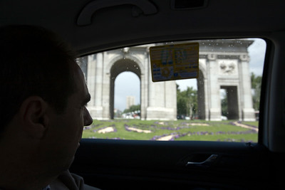 Taxi passenger looking at Alcala Gate, Madrid, Spain