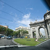 Alcala gate seen through the rear window of a taxi, Madrid, Spain