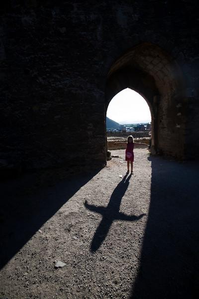 Little girl under an archway, Templar castle, town of Ponferrada, El Bierzo region, province of Leon, autonomous community of Castilla and Leon, northern Spain