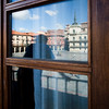 The town hall reflected on a window pane, town of Leon, autonomous community of Castilla y Leon, northern Spain