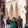 Young couples walking down the street with the Cathedral on the background, town of Leon, autonomous community of Castilla y Leon, northern Spain