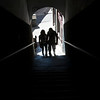 Couple through a passageway, town of Leon, autonomous community of Castilla y Leon, northern Spain