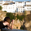 Young girl taking pictures of El Tajo gorge, town of Ronda, province of Malaga, Andalusia, Spain