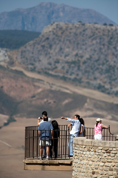 Visitors looking at El Tajo gorge, town of Ronda, province of Malaga, Andalusia, Spain