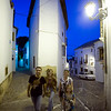 Visitors walking at dusk, town of Ronda, province of Malaga, Andalusia, Spain