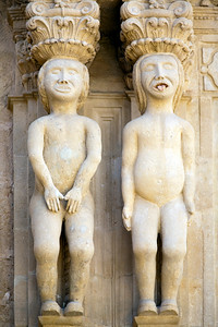 Nude figures with an Indian influence in his aspect, detail from the Palace of the Marquis of Salvatierra, town of Ronda, province of Malaga, Andalusia, Spain
