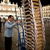 Restaurant employee putting the outside chairs away, town of Salamanca, autonomous community of Castilla and Leon, Spain