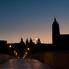 Roman bridge at dawn, with the silhouette of the New Cathedral on the skyline, town of Salamanca, autonomous community of Castilla and Leon, Spain
