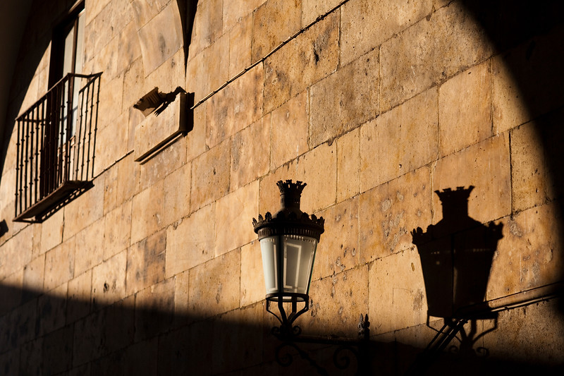 Light and shadows on a wall in the early morning, town of Salamanca, autonomous community of Castilla and Leon, Spain