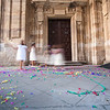 Children playing after a wedding ceremony at the door of Purisima Concepcion church, town of Salamanca, autonomous community of Castilla and Leon, Spain
