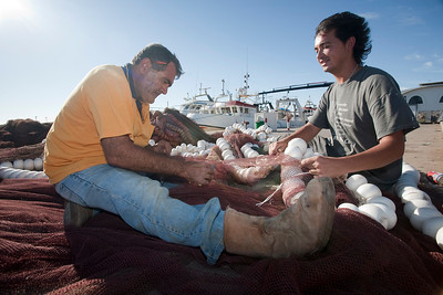 Fishermen fixing the nets. Bonanza port, town of Sanlucar de Barrameda, province of Cadiz, Andalusia, Spain.