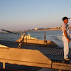 Sailor of the barge for crossing the Guadalquivir river. Bajo de Guia beach, town of Sanlucar de Barrameda, province of Cadiz, Andalusia, Spain.