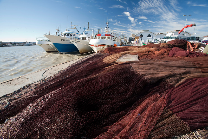 Fishing nets and boats, Bonanza port, town of Sanlucar de Barrameda, province of Cadiz, Andalusia, Spain.