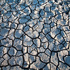 Cracked soil on a dried marshland. Town of Sanlucar de Barrameda, province of Cadiz, Andalusia, Spain.