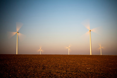 Electric generating windmills at dusk, town of Sanlucar de Barrameda, province of Cadiz, Andalusia, Spain.
