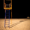 Lifeguard tower on the beach by night. Town of Sanlucar de Barrameda, province of Cadiz, Andalusia, Spain.