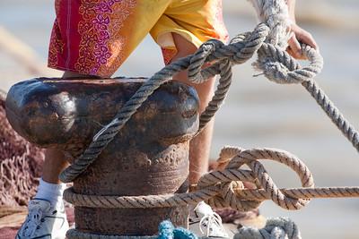 Mooring a boat. Bonanza port, town of Sanlucar de Barrameda, province of Cadiz, Andalusia, Spain.