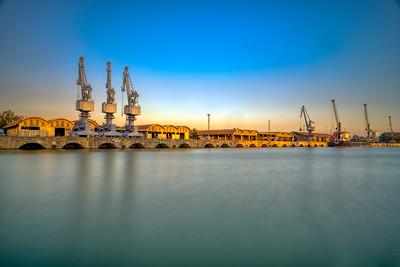 Single jib portal cranes, facilities of the river port of Seville, Spain.