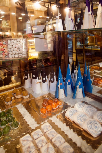 Shop window of La Campana candy store, showing sweets and toys shaped like Holy Week penitents, Seville, Spain