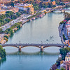 Aerial view of Triana (foreground) and San Telmo (background) bridges over the Guadalquivir river, Seville, Spain. High resolution vertical panorama.