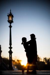 Young couple embracing at sunset, Plaza de España, Seville, Spain.
