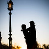 Young couple embracing at sunset, Plaza de España, Seville, Spain.
