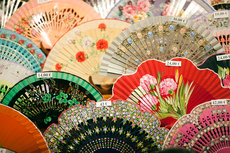 Handicraft fans on a souvenir shop, Sierpes street, Seville, Spain