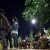 People sitting by night in terrace bar tables, Alameda de Hercules square, Seville, Spain