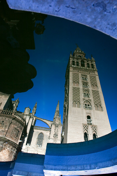 Giralda tower reflected on a fountain