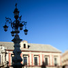 Fountain with lamps, Virgen de los Reyes square, Seville, Spain. Tilted lens used for shallower depth of field.