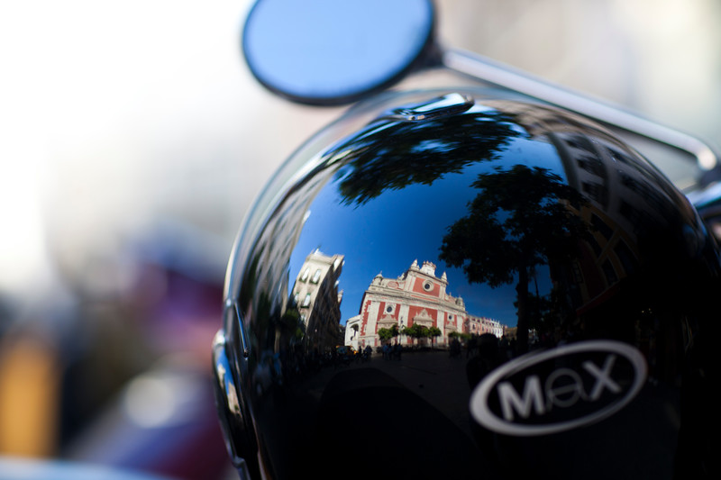 El Salvador church reflected on a crash helmet, Seville, Spain
