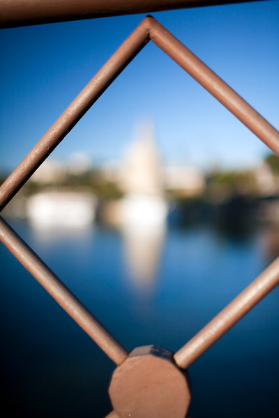 Torre del Oro (Golden Tower, 12th century) framed by San Telmo bridge railings. Seville, Andalusia, Spain