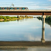 Metro de Sevilla (Undeground) train over the Guadalquivir river, San Juan de Aznalfarache, Seville, Spain.
